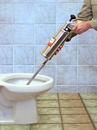 Прочистка засора в канализации при помощи пневмопистолета